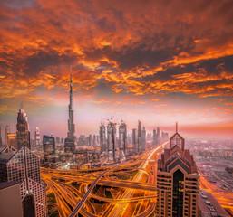 Dubai against colorful sunset with modern futuristic architecture , United Arab Emirates