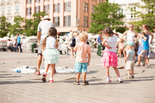 Children play with soap bubbles in the old city