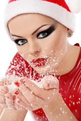 Woman with fancy gothic make-up, Santa's hat and snowflackes