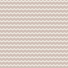 Abstract vector zig zag seamless pattern on the pale brown background. Ornament in pastel colors.