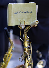 Detail from a new saxophone, wind musical instrument, shiny golden colored brass