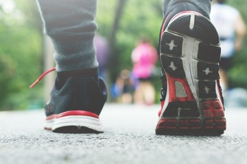 Athlete runner feet running on racetrack closeup on shoe. fitness  jog workout wellness concept.