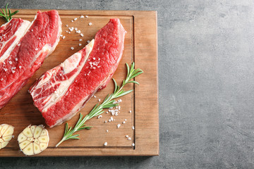 Fresh raw meat on wooden board