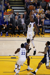 Durant of the Golden State Warriors jumps for a dunk during the first quarter of the NBA pre-season game against the Nuggets at Oracle Arena in Oakland