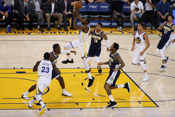 Durant of the Golden State Warriors jumps for a dunk during the first quarter of the NBA pre-season game against the Denver Nuggets  in Oakland
