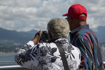 Elderly man female mountain ocean background travel