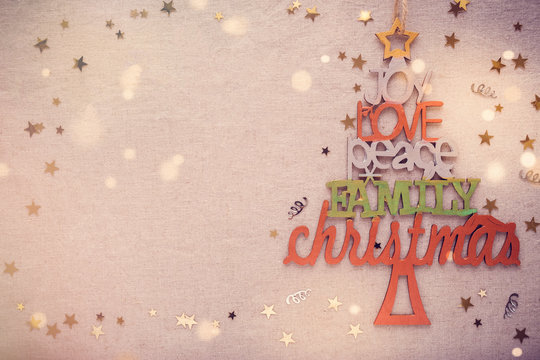 Christmas tree with love joy peace words, holidays copy space background