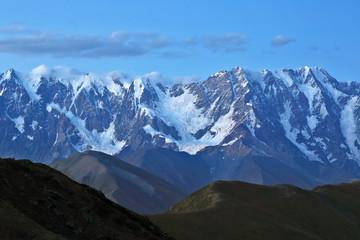 The Caucasus mountain range in the evening.