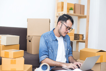 Young Asian Man Working at home, Young Owner Man Start up for Business Online, SME, Delivery Project, Man with Online Business or SME Concept.