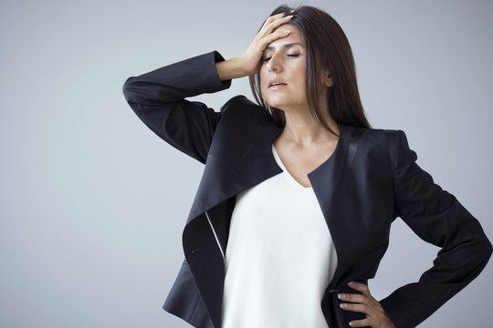 Unhappy businesswomen on the grey background