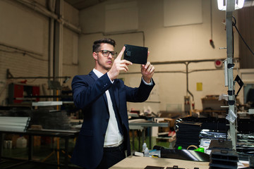 Supervisor taking photo of factory under inspection