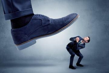 Cruel boss tramping his employee