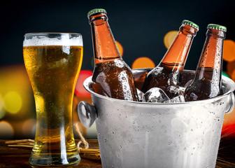 Beer bottles in ice bucket,