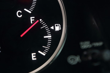Fuel gauge showing full car fuel