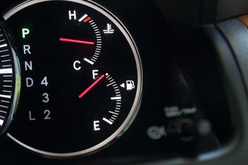 Fuel gauge showing full car fuel