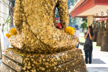 The Buddha statue to gild with gold leaf at thailand temple