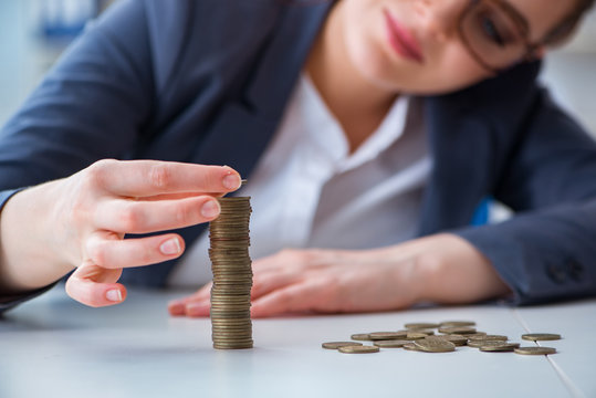 Businesswoman with coins in forex concept
