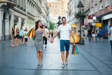 Couple walking in a city street