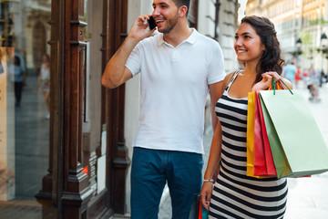 Beautiful young couple enjoying in shopping