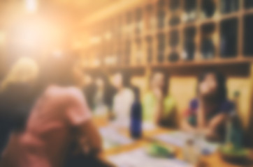 Blurred tourist group in restaurant and cafe for order and dinner in the evening. Blurred Background Concept.