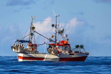mackerel hook line fishing vessel on blue ocean