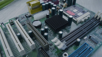 Motherboard close up. Electronic circuit board with processor, close up