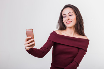 Close-up of young beautiful woman taking selfie