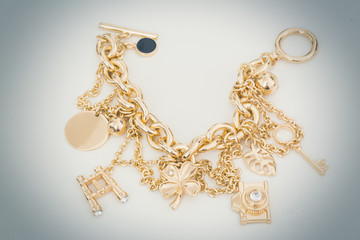 Gold charm bracelet with assorted charms