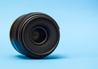 Camera lens on a blue background.
