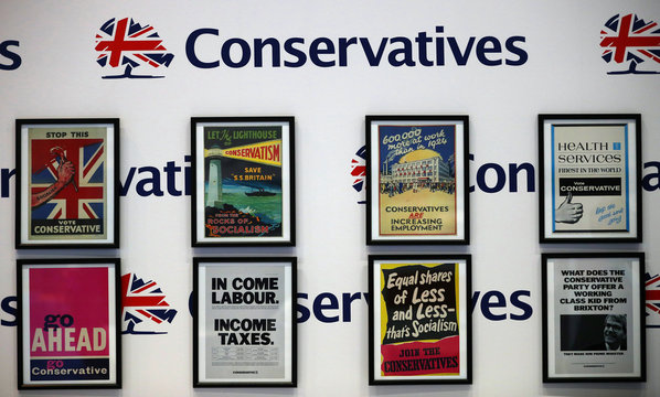 Vintage posters are displayed in the exhibition area at the conference centre on the opening day of the Conservative Party Conference, in Manchester