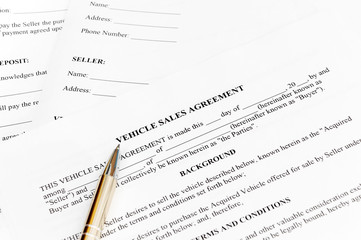 Vehicle sales agreement with pen.