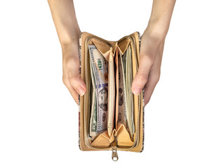Woman's hands holding wallet with money. Isolated on white.