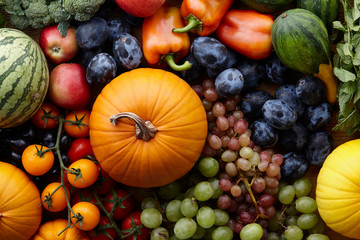 Autumn harvest concept. Seasonal fruits and vegetables on a wooden table, top view