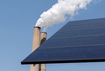 Smoking chimney stack and solar panel