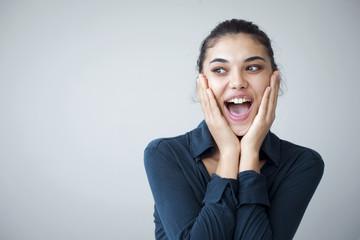 Surprised happy beautiful woman looking sideways in excitement