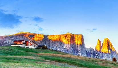 Wall Mural - Beautiful autumn morning sunrise scenery in Alps in South Tyrol region of Italian Dolomite Alps. View on mountain ridge. Trentino Alto Adidge, Italy, Alpe di Siusi - Seisser Alm. Fall season scene.
