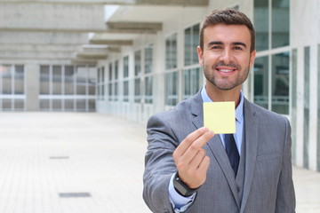 Businessman showing a note isolated