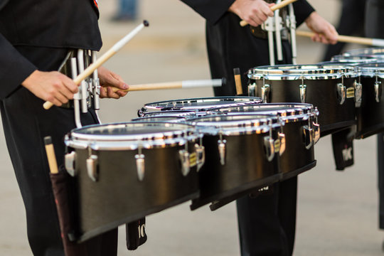 two marching band snare players warming up