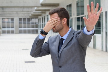Business covering his eyes to avoid reality