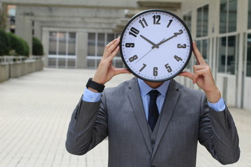 Businessman with a big clock covering his head