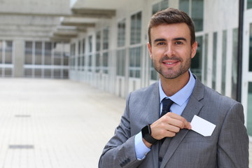 Salesman handing you a business card