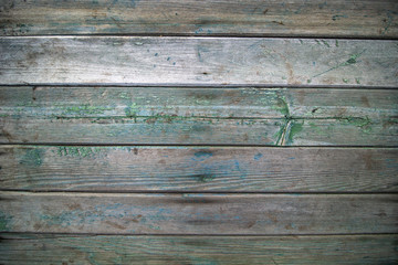 horizontal old weathered  wooden boards with green and blue traces of paint