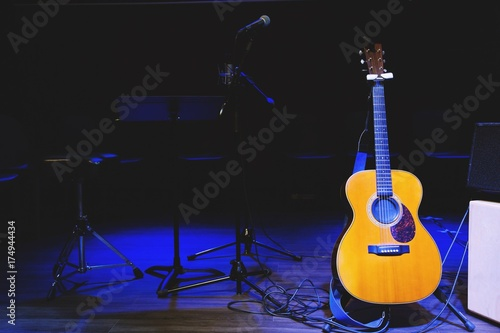 Acoustic Guitar Musical Instrument With On Stage In Concert Stock