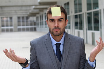 Businessman with a note on his forehead