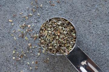A teaspoon of dried marjoram leaves