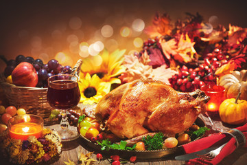 Roasted whole turkey on festive table for Thanksgiving Day