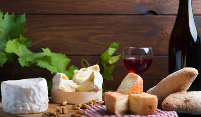 variation of cheese and wine and bread