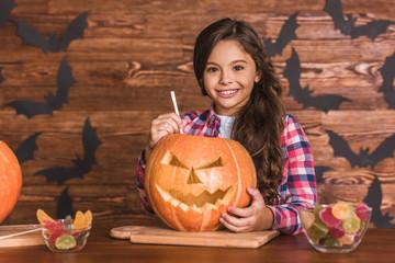 Little girl preparing for Halloween