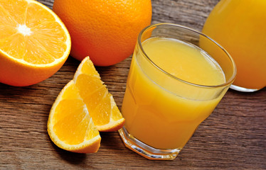 Orange fruits with juice in a glasses on table