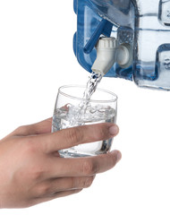 Glass filled with drinking water from faucet plastic water container isolated on a white background